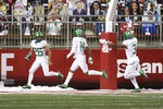 Oregon running back Travis Dye (26) celebrates his touchdown with teammates Kris Hutson (14) and Johnny Johnson III (3) during the second half of the team's NCAA college football game against Washington State in Pullman, Wash., Saturday, Nov. 14, 2020. Oregon won 43-29. (AP Photo/Young Kwak)