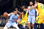 Memphis Grizzlies' Dillon Brooks (24) drives past Utah Jazz's Mike Conley (10) during the first half of an NBA basketball game Friday, Nov. 15, 2019, in Memphis, Tenn. (AP Photo/Karen Pulfer Focht)