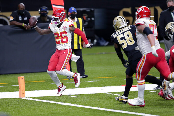 Kansas City Chiefs running back Le'Veon Bell (26) crosses the goal line past New Orleans Saints outside linebacker Kwon Alexander (58) on a touchdown carry in the second half of an NFL football game in New Orleans, Sunday, Dec. 20, 2020. (AP Photo/Brett Duke)