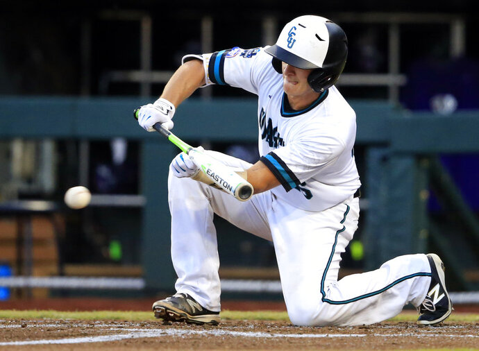FILE - In this June 21, 2016 file photo, Coastal Carolina's Matt Beaird puts down a sacrifice bunt during the third inning of an NCAA College World Series baseball game against TCU in Omaha, Neb. Run at your own risk against Beaird. Coastal Carolina's senior catcher has thrown out 22 of 32 would-be base stealers. That's 69 percent. Now consider the major league caught-stealing rate is 27 percent. (AP Photo/Nati Harnik, File)