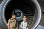 German defense minister  Ursula von der Leyen,right, is accompanied by an unidentified German soldier after her arrival to Azraq air base in northern Jordan Saturday, Jan. 13, 2018. The Germany's defense minister is visiting a Jordanian air base where German troops have been stationed since October as part of an international military campaign against Islamic State extremists. A group of German parliamentarians accompanied Ursula von der Leyen on Saturday during her tour of the Azraq base in northern Jordan. (Michael Kappeler/Pool via AP)