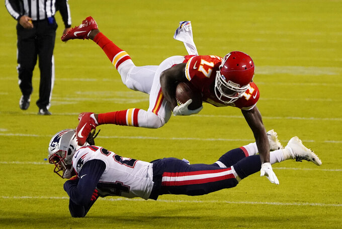 Kansas City Chiefs wide receiver Mecole Hardman (17) is tackled by New England Patriots cornerback Stephon Gilmore after catching a pass during the second half of an NFL football game, Monday, Oct. 5, 2020, in Kansas City. (AP Photo/Jeff Roberson)