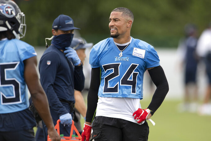Tennessee Titans strong safety Kenny Vaccaro (24) takes a break during NFL football training camp Friday, Aug. 14, 2020, in Nashville, Tenn. (George Walker IV/Pool Photo via AP)