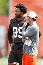 Cleveland Browns head coach Kevin Stefanski talks with defensive end Myles Garrett (95) during an NFL football practice Thursday, Aug. 12, 2021, in Berea, Ohio. (AP Photo/Ron Schwane)
