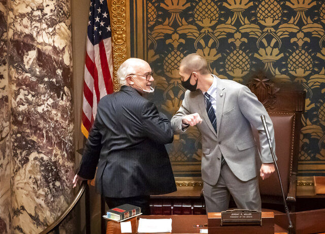 Outgoing Senate President Senate President Jeremy Miller, R-Winona gave Sen. David Tomassoni, DFL-Chisholm a congratulatory elbow bump before Tomassoni addressed the Senate Chamber. By a vote of 63-4, Iron Range DFL Sen. David Tomassoni has been approved to become the new president of the Minnesota Senate, which is controlled by Republicans. This is the first time a Minnesota Senate President is from the minority party. (Glen Stubbe/Star Tribune via AP)