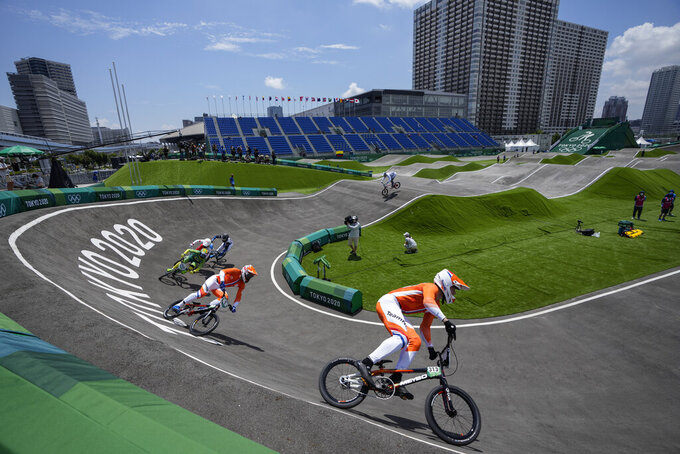 Niek Kimmann of the Netherlands, right, is followed by Twan van Gendt of the Netherlands, Renato Rezende of Brazil, James Palmer of Canada, Nicolas Torres of Argentina, and Helvijs Babris of Latvia in the men's BMX Racing quarterfinals at the 2020 Summer Olympics, Thursday, July 29, 2021, in Tokyo, Japan. (AP Photo/Ben Curtis)