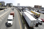 In an April 17, 2019, file photo, a general view shows vehicles, right, approaching the George Washington Bridge toll plaza in Fort Lee, N.J. The Port Authority of New York and New Jersey, which operates New York's airports and many of its bridges and tunnels is proposing fare and toll hikes across a broad swath of its facilities, some potentially taking effect as early as this fall, to keep pace with inflation and help fund more than $30 billion in capital projects over the next decade. (AP Photo/Julio Cortez, File)
