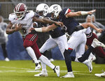 Massachusetts running back Marquis Young (8) gains yardage while pursued by Connecticut defensive back Tahj Herring-Wilson (14) and Connecticut linebacker Eddie Hahn (6) during the first half of an NCAA college football game, Saturday, Oct. 27, 2018, in East Hartford, Conn. (AP Photo/Jessica Hill)