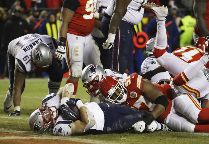 New England Patriots running back Rex Burkhead (34) dives to the end zone for a touchdown to win the AFC Championship NFL football game against the Kansas City Chiefs in overtime, Sunday, Jan. 20, 2019, in Kansas City, Mo. (AP Photo/Elise Amendola)