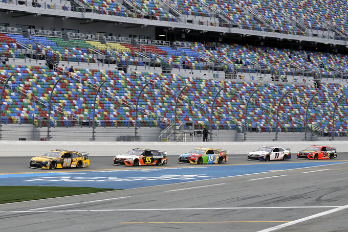 Erik Jones (20) leads Christopher Bell (95), Kyle Busch (18), Denny Hamlin (11) and Martin Truex Jr. (19) in a draft during practice for the NASCAR Daytona 500 auto race Friday, Feb. 14, 2020, at Daytona International Speedway in Daytona Beach, Fla. (AP Photo/Chris O'Meara)