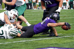 Northwestern running back Jake Arthurs, right, scores a touchdown past Ohio linebacker Ben Johnson, left, and linebacker Jack McCrory during the second half of an NCAA college football game in Evanston, Ill., Saturday, Sept. 25, 2021. Northwestern won 35-6. (AP Photo/Nam Y. Huh)