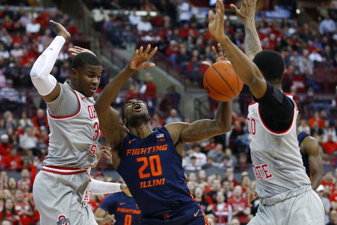 Illinois' Da'Monte Williams, center, loses control of the ball as Ohio State's E.J. Liddell, left, and Luther Muhammad defend during the first half of an NCAA college basketball game Thursday, March 5, 2020, in Columbus, Ohio. (AP Photo/Jay LaPrete)