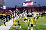 Iowa players including wide receiver Ihmir Smith-Marsette (6) and defensive back Michael Ojemudia (11) celebrate following an NCAA college football game against Nebraska in Lincoln, Neb., Friday, Nov. 29, 2019. Iowa won 27-24. (AP Photo/Nati Harnik)