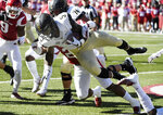 Vanderbilt running back Ke'Shawn Vaughn is tripped up by an Arkansas defender in the first half of an NCAA college football game Saturday, Oct. 27, 2018, in Fayetteville, Ark. (AP Photo/Michael Woods)
