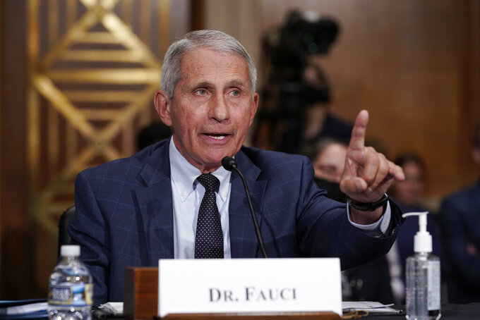 Top infectious disease expert Dr. Anthony Fauci responds to accusations by Sen. Rand Paul, R-Ky., as he testifies before the Senate Health, Education, Labor, and Pensions Committee, on Capitol Hill in Washington, Tuesday, July 20, 2021. Cases of COVID-19 have tripled over the past three weeks, and hospitalizations and deaths are rising among unvaccinated people. (AP Photo/J. Scott Applewhite, Pool)