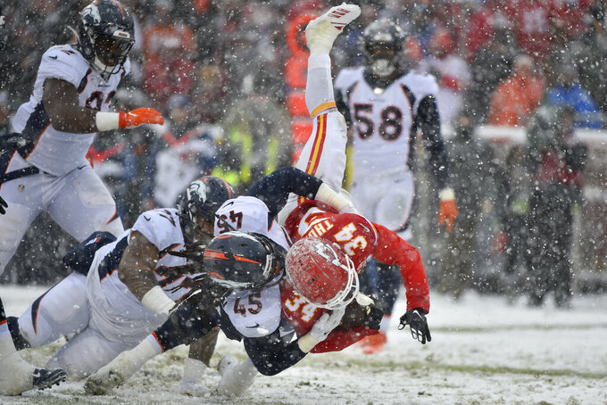 Kansas City Chiefs running back Darwin Thompson (34) is tackled by Denver Broncos linebacker Alexander Johnson (45) during the second half of an NFL football game in Kansas City, Mo., Sunday, Dec. 15, 2019. (AP Photo/Ed Zurga)