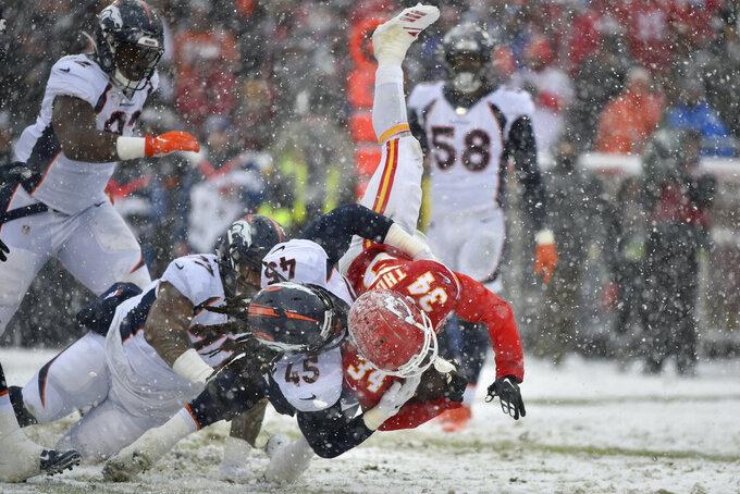 Kansas City Chiefs running back Darwin Thompson (34) is tackled by Denver Broncos linebacker Alexander Johnson (45) during the second half of an NFL football game in Kansas City, Mo., Sunday, Dec. 15, 2019. (AP Photo/Ed Zurga)