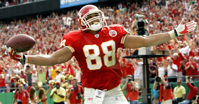 FILE - In this Oct. 14, 2007, file photo, Kansas City Chiefs tight end Tony Gonzalez celebrates his second touchdown catch of the game during the fourth quarter of a football game against the Cincinnati Bengals, in Kansas City, Mo. Gonzalez will be inducted into the Pro Football Hall of Fame in Canton, Ohio on Aug. 3, 2019.(AP Photo/Charlie Riedel, File)