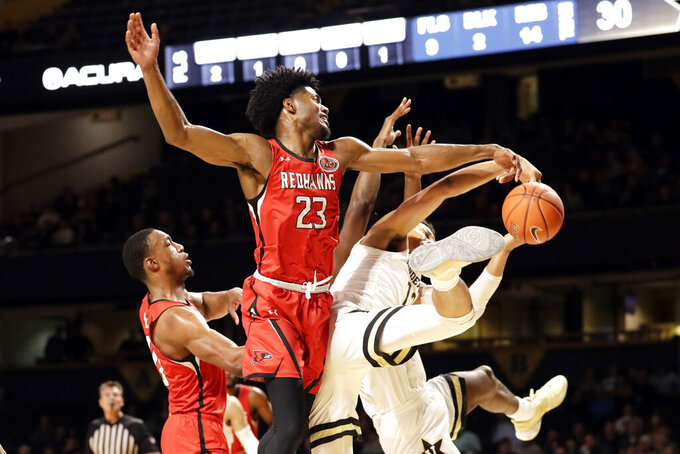 Southeast Missouri State forward Sage Tolbert (23) fights for the ball in the first half of an NCAA college basketball game against Vanderbilt Wednesday, Nov. 6, 2019, in Nashville, Tenn. (AP Photo/Mark Humphrey)