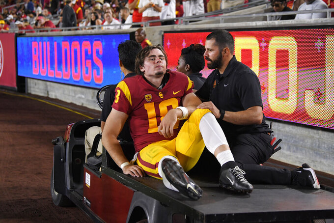 Southern California quarterback JT Daniels is carted off the field after being injured during the first half of an NCAA college football game against Fresno State Saturday, Aug. 31, 2019, in Los Angeles. (AP Photo/Mark J. Terrill)