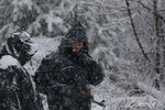 Bosnian police secure an area in Bradina, Bosnia, Monday, Feb. 11, 2019. Police in Bosnia say they have launched a manhunt for a suspect in the killings of two people in the past week which has triggered panic in the country. (AP Photo/Amel Emric)