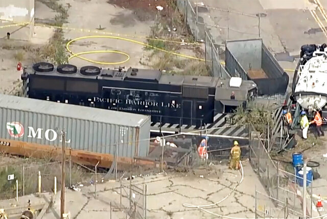 This aerial image taken from video provided by KABC-TV shows a Pacific Harbor Line train that derailed Tuesday, March 31, 2020, at the Port of Los Angeles after running through the end of the track and crashing through barriers, finally coming to rest about 250 yards from the docked U.S. Navy Hospital Ship Mercy. The train engineer intentionally drove the speeding locomotive off a track at the Port of Los Angeles because he was suspicious about the presence of a Navy hospital ship docked there amid the coronavirus crisis. (KABC-TV via AP)