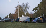 Media prepares in the early morning at the entrance of the castle in Sandringham, England, Monday, Jan. 13, 2020. Prince Harry and his wife Meghan have declared they will