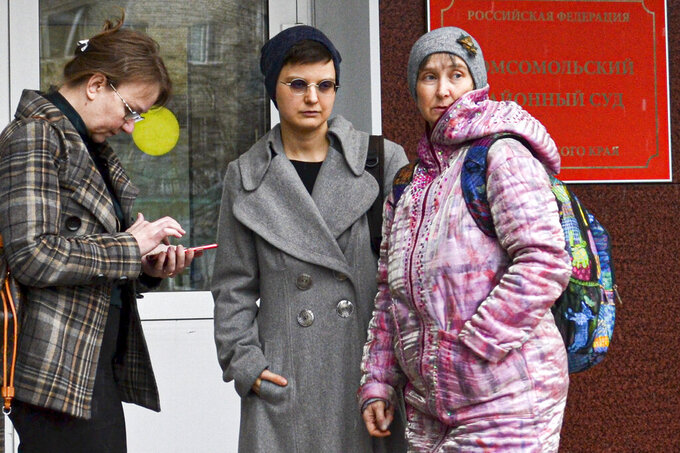 "Feminist activist and artist Yulia Tsvetkova, center, her mother Anna Khodyreva, right, and her lawyer Irina Ruchko leave a court session in Komsomolsk-on-Amur, Russia, Monday, April 12, 2021. Tsvetkova, 27, stands trial on charges of disseminating pornography after she shared artwork depicting female anatomy online. The controversial case, in line with the Kremlin's conservative stance promoting ""traditional family values,"" has elicited outrage at home and abroad, with human rights organizations urging the authorities to drop all charges against Tsvetkova. (AP Photo/Alexander Permyakov)"