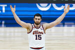Illinois forward Giorgi Bezhanishvili (15) celebrates during the second half of an NCAA college basketball championship game against Ohio State at the Big Ten Conference tournament, Sunday, March 14, 2021, in Indianapolis. (AP Photo/Michael Conroy)