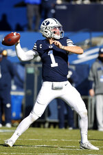 BYU quarterback Zach Wilson (1) looks to pass against North Alabama in the first quarter during an NCAA college football game Saturday, Nov. 21, 2020, in Provo, Utah. (AP Photo/Jeff Swinger, Pool)