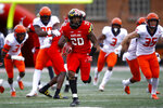 Maryland running back Javon Leake (20) rushes past a group of Illinois defenders for a touchdown in the first half of an NCAA college football game, Saturday, Oct. 27, 2018, in College Park, Md. (AP Photo/Patrick Semansky)