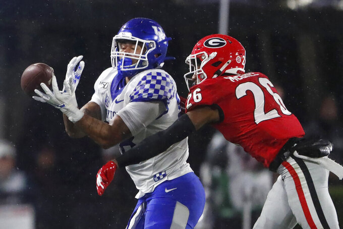 Georgia defensive back Tyrique McGhee (26) breaks up a pass intended for Kentucky tight end Keaton Upshaw (88) during the first half of an NCAA college football game Saturday, Oct. 19, 2019, in Athens, Ga. (AP Photo/John Bazemore)