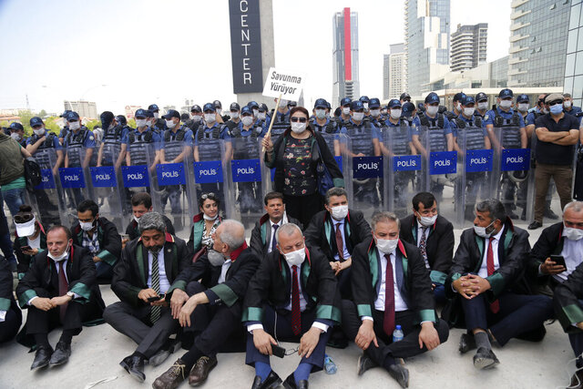 The heads of several Turkish lawyers' associations stage a sit-in demonstration after police blocked the group from marching to the capital, Ankara, Turkey, Monday, June 22, 2020. The heads of Bar Associations from various cities embarked on a march to Ankara last week in their robes to protest government plans to amend laws regulating lawyers and their associations. (AP Photo)