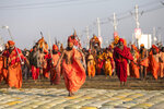 Hindu holy men arrive for ritualistic dip on auspicious Makar Sankranti day during the Kumbh Mela, or pitcher festival in Prayagraj, Uttar Pradesh state, India, Tuesday, Jan.15, 2019. The Kumbh Mela is a series of ritual baths by Hindu holy men, and other pilgrims at the confluence of three sacred rivers the Yamuna, the Ganges and the mythical Saraswati  that dates back to at least medieval times. The city's Mughal-era name Allahabad was recently changed to Prayagraj. (AP Photo/Bernat Armangue)