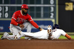 Houston Astros' Jose Siri, right, steals second past Los Angeles Angels shortstop Luis Rengifo during the fourth inning of a baseball game, Saturday, Sept. 11, 2021, in Houston. (AP Photo/Eric Christian Smith)