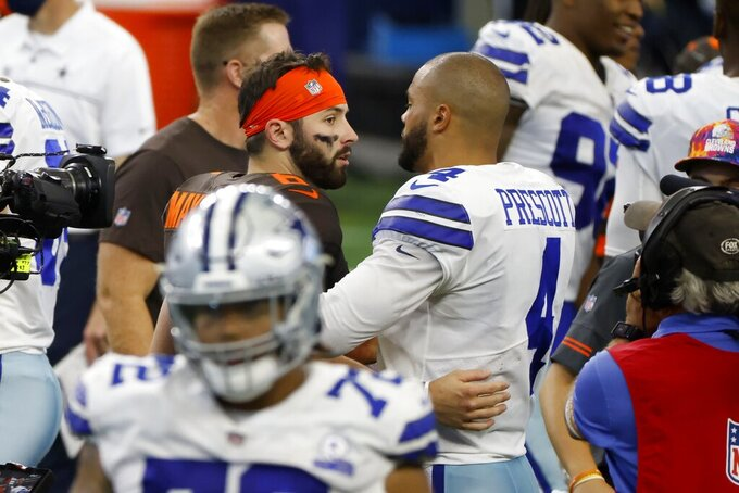 Cleveland Browns quarterback Baker Mayfield, center left, and Dallas Cowboys quarterback Dak Prescott (4) greet each other after their NFL football game in Arlington, Texas, Sunday, Oct. 4, 2020. (AP Photo/Ron Jenkins)