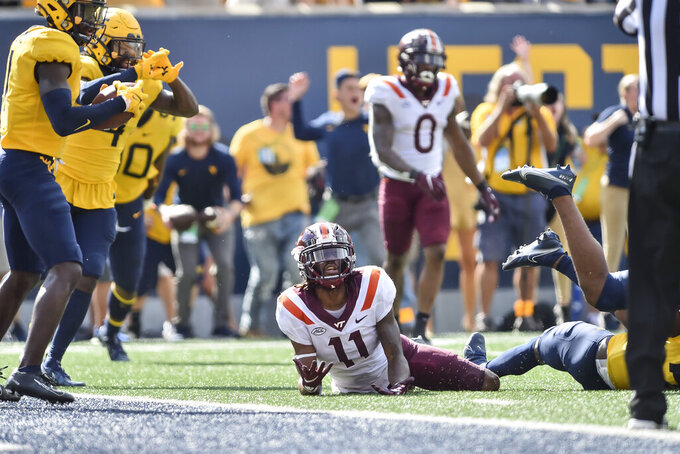 Virginia Tech wide receiver Tre Turner (11) reacts after the final play of the game against West Virginia in the second half of an NCAA college football game in Morgantown, W.Va., Saturday, Sep. 18, 2021. (AP Photo/William Wotring)