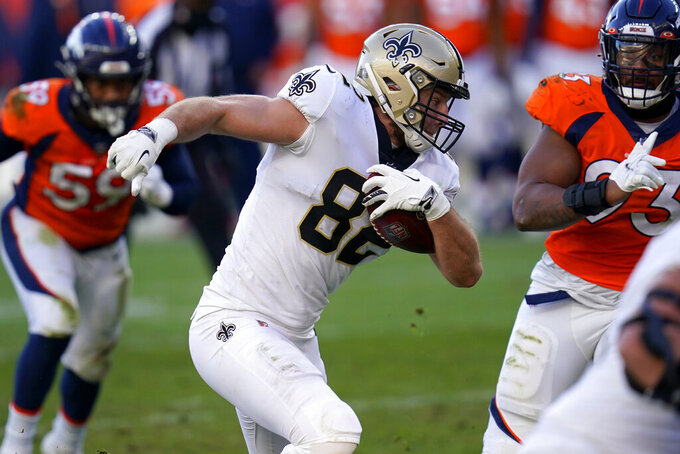 New Orleans Saints tight end Adam Trautman (82) runs the ball after the catch during the first half of an NFL football game against the Denver Broncos, Sunday, Nov. 29, 2020, in Denver. (AP Photo/David Zalubowski)