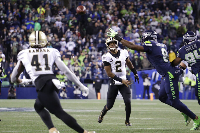 New Orleans Saints quarterback Jameis Winston (2) passes to running back Alvin Kamara (41) for a touchdown against the Seattle Seahawks during the first half of an NFL football game, Monday, Oct. 25, 2021, in Seattle. (AP Photo/John Froschauer)