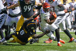 Pittsburgh Steelers linebacker Melvin Ingram (8) tries to bring down Pittsburgh Steelers safety Miles Killebrew (28) during the second half an NFL football game, Sunday, Sept. 26, 2021, in Pittsburgh. (AP Photo/Gene J. Puskar)