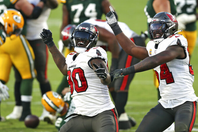 Tampa Bay Buccaneers outside linebacker Jason Pierre-Paul (90) and inside linebacker Lavonte David (54) celebrate after sacking Green Bay Packers quarterback Aaron Rodgers (12) during the second half of an NFL football game Sunday, Oct. 18, 2020, in Tampa, Fla. (AP Photo/Mark LoMoglio)