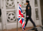The British Union flag flies from the front of a car as British ambassador to Russia, Laurie Bristow attends a meeting at the Russian foreign ministry in Moscow,Tuesday March 13, 2018. Russia will only cooperate with Britain on the investigation into last week's poisoning of an ex-Russian spy Sergei Skripal and his daughter Yulia if it receives samples of the nerve agent that is believed to have been used, Russia's foreign minister Lavrov said Tuesday. (AP Photo/Alexander Zemlianichenko)