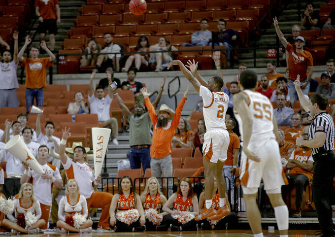 Texas guard Matt Coleman III (2) shoots a 3-pointer against Colorado during an NCAA college basketball game in the quarterfinals of the NIT on Wednesday, March 27, 2019, in Austin, Texas. (Nick Wagner/Austin American-Statesman via AP)