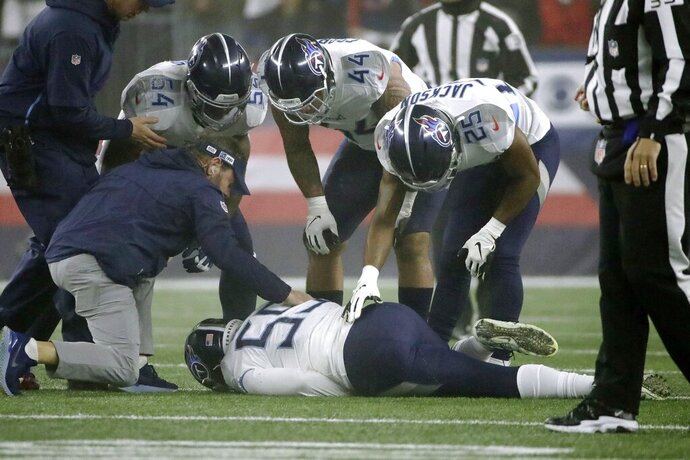 Tennessee Titans linebacker Jayon Brown receives attention on the field after an injury in the first half of an NFL wild-card playoff football game against the New England Patriots, Saturday, Jan. 4, 2020, in Foxborough, Mass. (AP Photo/Elise Amendola)