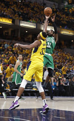 Boston Celtics guard Kyrie Irving (11) shoots over Indiana Pacers center Myles Turner (33) during the second half of Game 3 of an NBA basketball first-round playoff series Friday, April 19, 2019, in Indianapolis. (AP Photo/Darron Cummings)