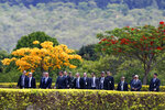 In this Tuesday, Nov. 19, 2019 photo, Brazil's President Jair Bolsonaro, fifth from left, accompanied by his Cabinet, arrives for a Flag Day ceremony at the Alvorada Palace, in Brasilia, Brazil. Officially adopted in 1889, Brazil's flag is known in Portuguese as verde e amarela, or the green and yellow, which is celebrated annually on Nov. 19. (AP Photo/Eraldo Peres)