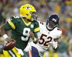 FILE - In this Sept. 9, 2018, file photo, Chicago Bears' Khalil Mack rushes Green Bay Packers' DeShone Kizer during the first half of an NFL football game, in Green Bay, Wis. Von Miller might be the only one at Denver Broncos headquarters lamenting Khalil Mack's startling trade from the Oakland Raiders to the Chicago Bears. The Broncos' star linebacker said it's