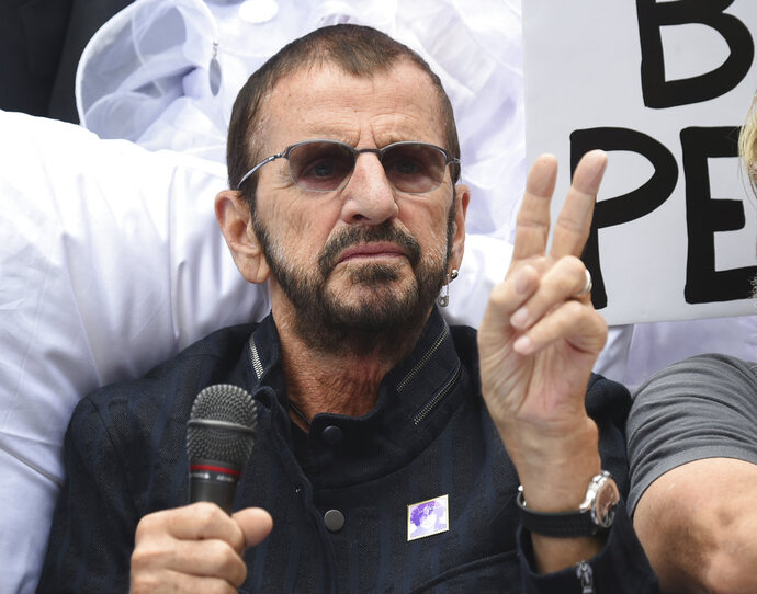 Musician Ringo Starr participates in the fifth annual Come Together: NYC bed-in celebration to support New York City schools and to promote the return of the John Lennon Educational Tour Bus at City Hall on Thursday, Sept. 13, 2018, in New York. Within a week of Paul McCartney playing a surprise show at Grand Central Station, Starr followed a more old-fashioned path Thursday night. The 78-year-old drummer and singer headlined a two-hour show at Radio City Music Hall, with thousands spending much of the performance standing and singing along. (Photo by Evan Agostini/Invision/AP)