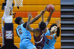 Texas Southern forward Justin Hopkins (15) is fouled by Oklahoma State forward Matthew-Alexander Moncrieffe (12) as he goes to the basket between Moncrieffe and guard Cade Cunningham (2) in the second half of an NCAA college basketball game in Stillwater, Okla., Saturday, Nov. 28, 2020. (AP Photo/Sue Ogrocki)