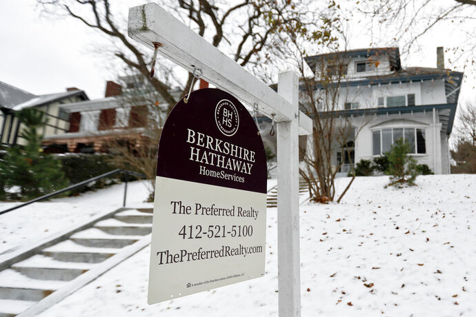 In this Nov. 28, 2018, photo, a realtor sign hangs in front of a home for sale in Pittsburgh. On Thursday, Nov. 29, Freddie Mac reports on the week's average U.S. mortgage rates. (AP Photo/Keith Srakocic)